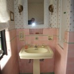 old pink tile and yellow sink