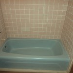 blue bathtub and beige tile