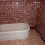 artdeco tub and red tile