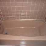 beige tub and tile before refinish in white